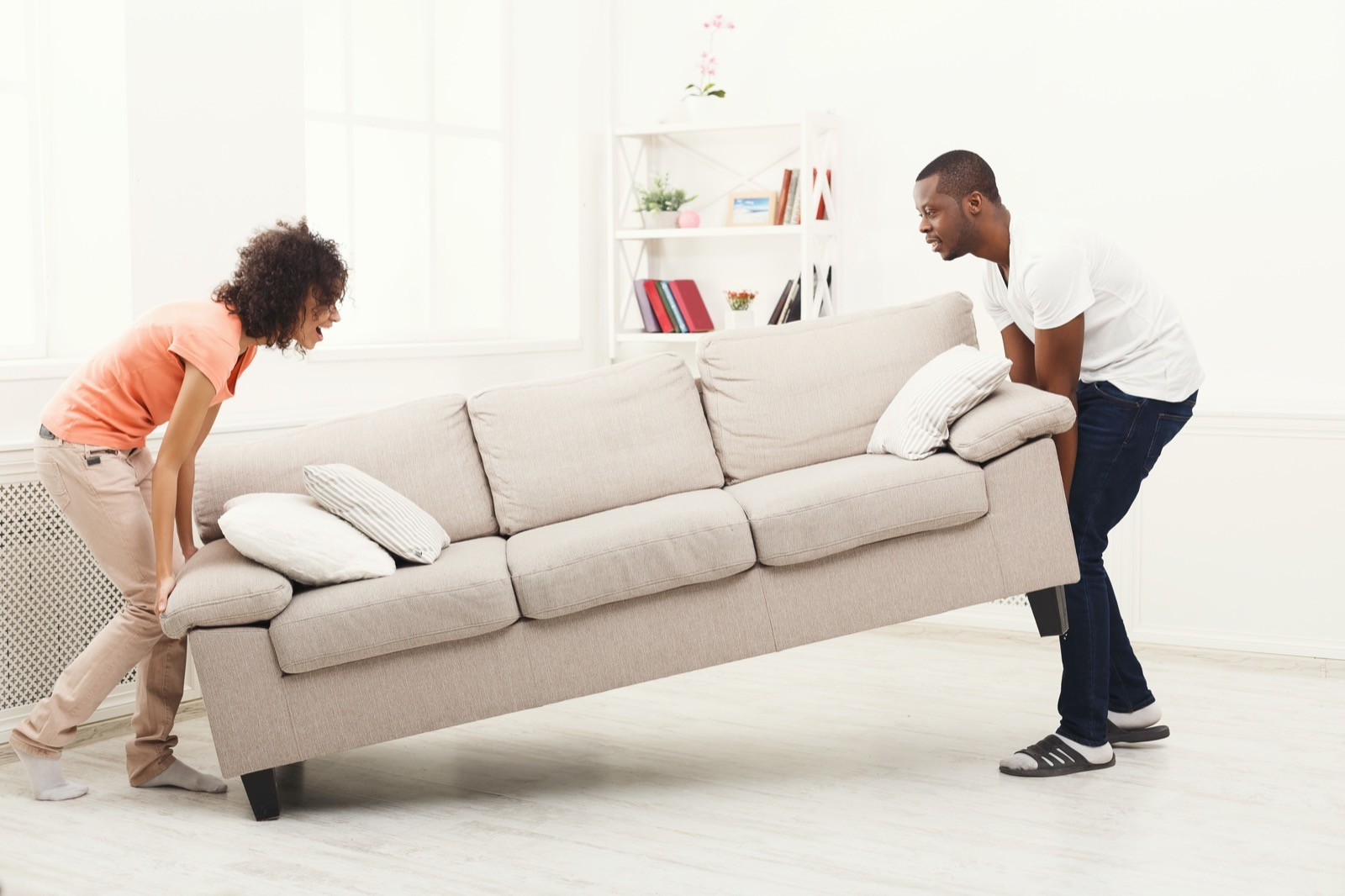 Couple moving couch | Flooring by Wilson's Carpet Plus