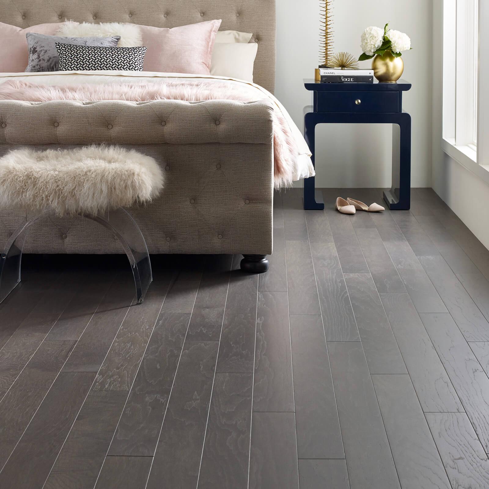 hardwood flooring in bedroom | Flooring by Wilson's Carpet Plus