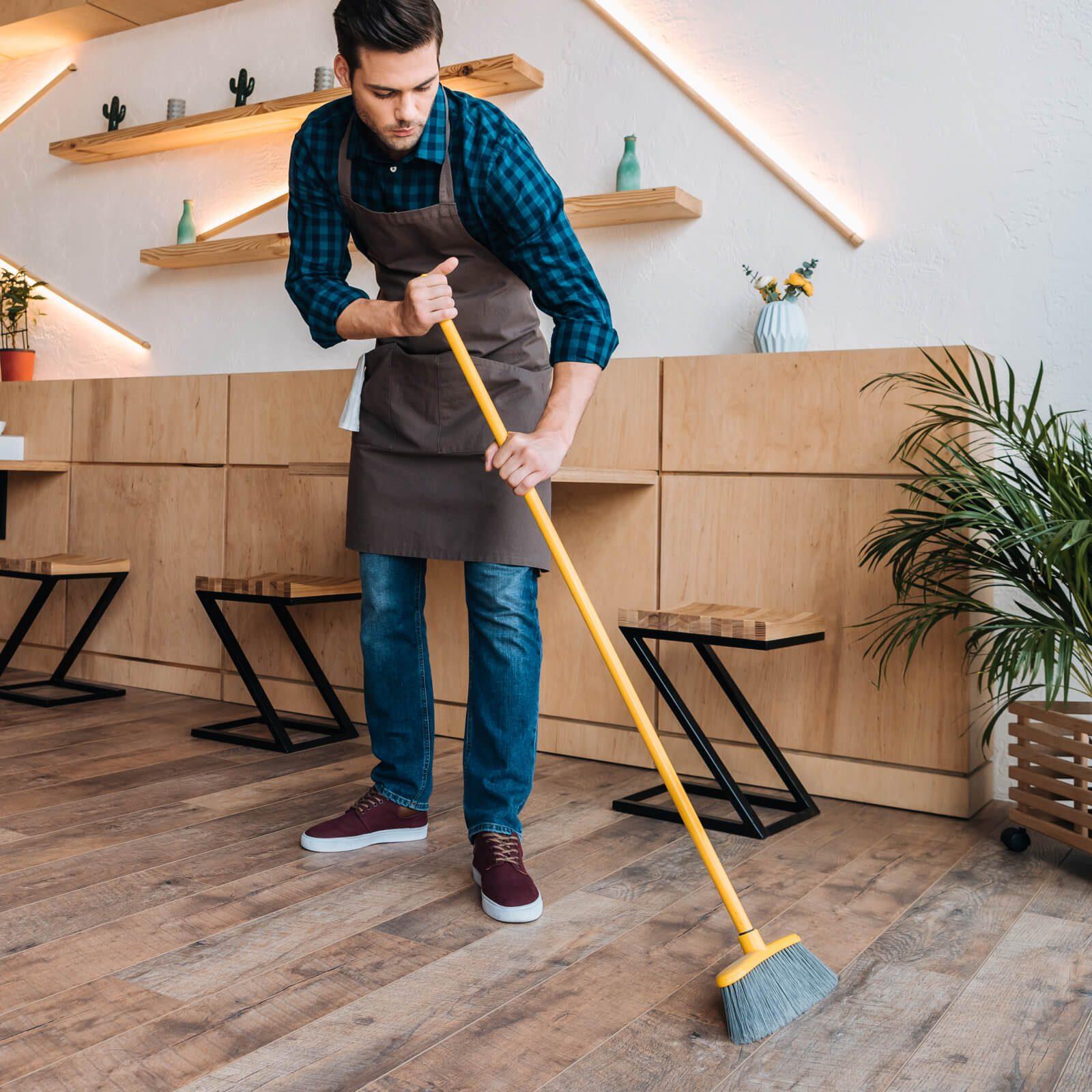 Hardwood floor sweeping | Flooring by Wilson's Carpet Plus