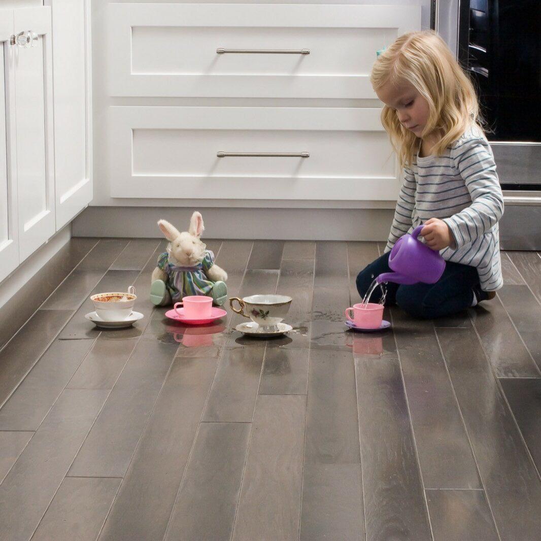 child playing on luxury vinyl flooring in kitchen | Flooring by Wilson's Carpet Plus